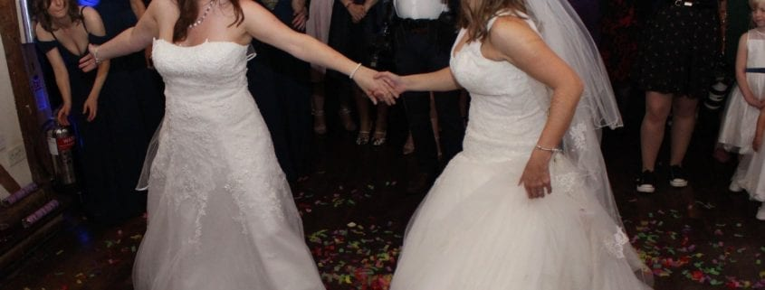 Mrs Mrs Stapely-Heinds Leaving their wedding ceremony